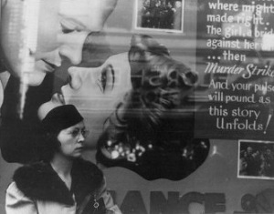Girl And Movie Poster, Cincinnati, Ohio, 1938 by WPA Photographer John Vachon